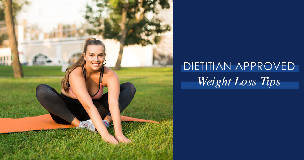 """Brunette model doing yoga in the grass with the words """"dietitian approved weight loss tips"""" in a text box next to her."""