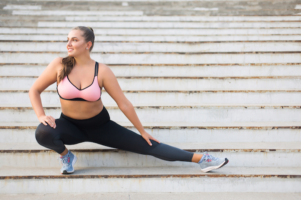 Woman stretching on staircase on before a run